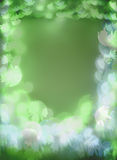 Green and blue bokeh lights with flower shapes. On green background Stock Image