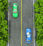 Green and blue cars on the road, the view from the top Stock Images