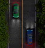 Green and blue cars on the road, the view from the top. night Royalty Free Stock Image