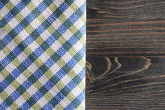 Green with blue checkered napkin on gray wooden table Royalty Free Stock Photos