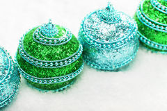 Green and blue Christmas balls in snow, christmas background. Christmas banner with copy space Royalty Free Stock Image