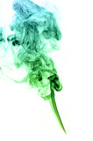 Green and blue colored real smoke on white background Royalty Free Stock Image