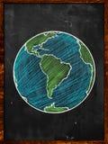 Green blue Earth on Blackboard. Globe background Stock Photos