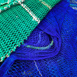 Green and blue fishing nets Stock Photo