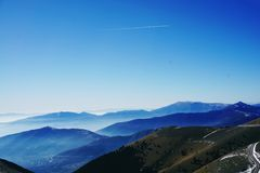 Green and Blue Fog Covered Mountains Under Blue Sky Stock Images