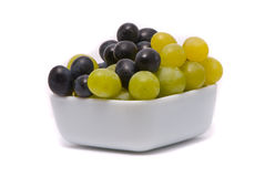 Green and blue grapes Stock Photos