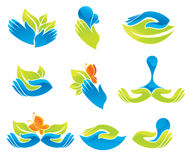 Green and blue hands Stock Photos