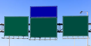 Green and blue highway signs Stock Photos