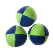 Green blue juggling balls. Material soft juggling balls. Three juggling balls on white backgrounds Royalty Free Stock Photos