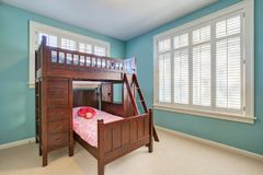 Green and blue kids room with bunk bed royalty free stock images