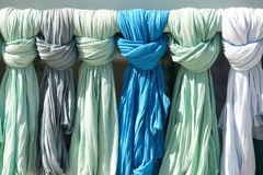 Green and blue ladies scarves in a tourist shop. Crete. Greece Royalty Free Stock Photos