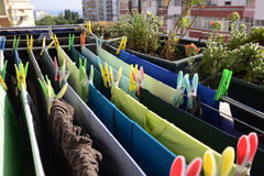 Green and Blue Laundry Drying, Colorful Pins, Home Royalty Free Stock Image