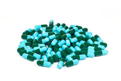 Green and blue medical capsules. Close-up of green and blue medical capsules Stock Images