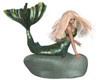 Green and Blue Mermaid on a Rock Stock Photo