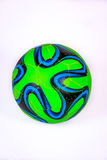 Green with a blue pattern soccer ball Stock Photos