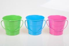 Green, blue and pink pails Stock Photo