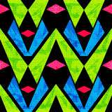 Green blue and pink polygons on a black background seamless pattern vector illustration grunge effect Stock Photography