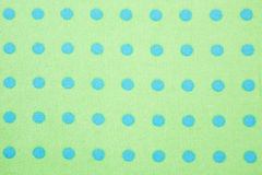Green with blue polka dots background pattern stock image