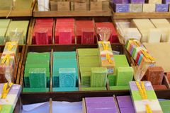 Green blue purple yellow and red soap at a farmer market in France, Europe. Italian hand made soap. Street French market at Nice. Natural soap made by local Royalty Free Stock Photos