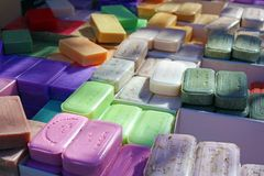 Green blue purple yellow and red soap at a farmer market in France, Europe. Italian hand made soap. Street French market at Nice. Natural soap made by local Stock Images