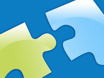 Green and Blue Puzzle Pieces. A green and blue puzzle piece are coming together Stock Photos