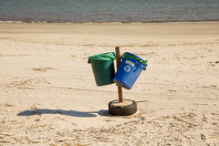 Green and Blue Recycle Bins on Beach Royalty Free Stock Photography
