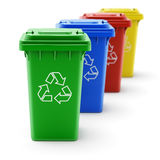 Green, blue, red and yellow recycle bins Stock Photography