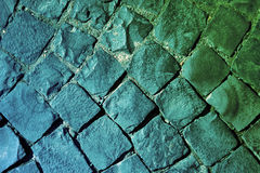 Green and blue road. Road covered with stones in green colours Royalty Free Stock Images