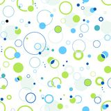 Green and blue seamless dots and circle pattern. Abstract dotted wallpaper that will tile seamlessly. 5 global colors Royalty Free Stock Image