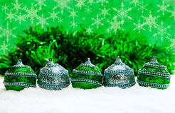 Green and blue and silver Christmas balls in snow with tinsel and snowflakes, christmas background Stock Images