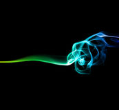 Green and blue smoke on dark Stock Images