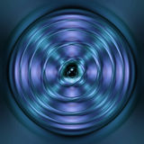 Green and blue spinning atom Stock Photos