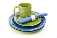 Green and Blue Tableware. Setting with plates, coffee mug, and cloth napkin Stock Photography