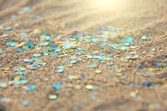 Green, blue or turquoise Soft Blurred Boke Background. Spangles and Shiny Silver Color Background. Bright Background. Glamorous. Background for your design and stock photography