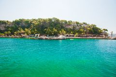 Green, blue water on the coast of the beach, a resort for swimming royalty free stock photo