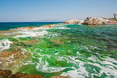 Green, blue water on the coast of the beach, a resort for swimming royalty free stock photos