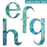 Green-blue watercolor font E,F,G,H Stock Image