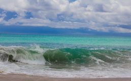 A green blue wave on the beach royalty free stock photo