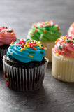 Green and Blues Easter Muffins with Sprinkles on Granite Counter Royalty Free Stock Photos
