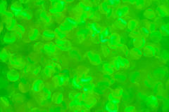Green blurred glitters defocused background stock photos