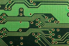Green Board electronic printed circuit Board PCB. Bright beautiful background stock photography