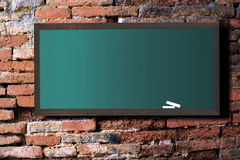 Green board on old wall royalty free stock photos