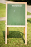Green board in the park outdoor Royalty Free Stock Photo