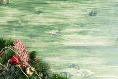 Green board with pine needles and cones Christmas toys and Chris Stock Image