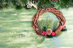 Green board with pine needles and cones Christmas toys and Chris Stock Images