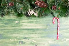 Green board with pine needles and cones Christmas toys and Chris Royalty Free Stock Photo