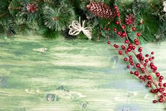 Green board with pine needles and cones Christmas toys and Chris Royalty Free Stock Images