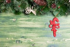 Green board with pine needles and cones Christmas toys and Chris Stock Photo