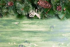 Green board with pine needles and cones Christmas toys and Chris Stock Photos