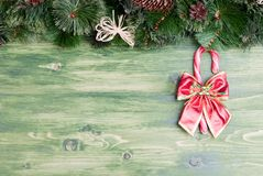 Green board with pine needles and cones Christmas toys and Chris Royalty Free Stock Photos